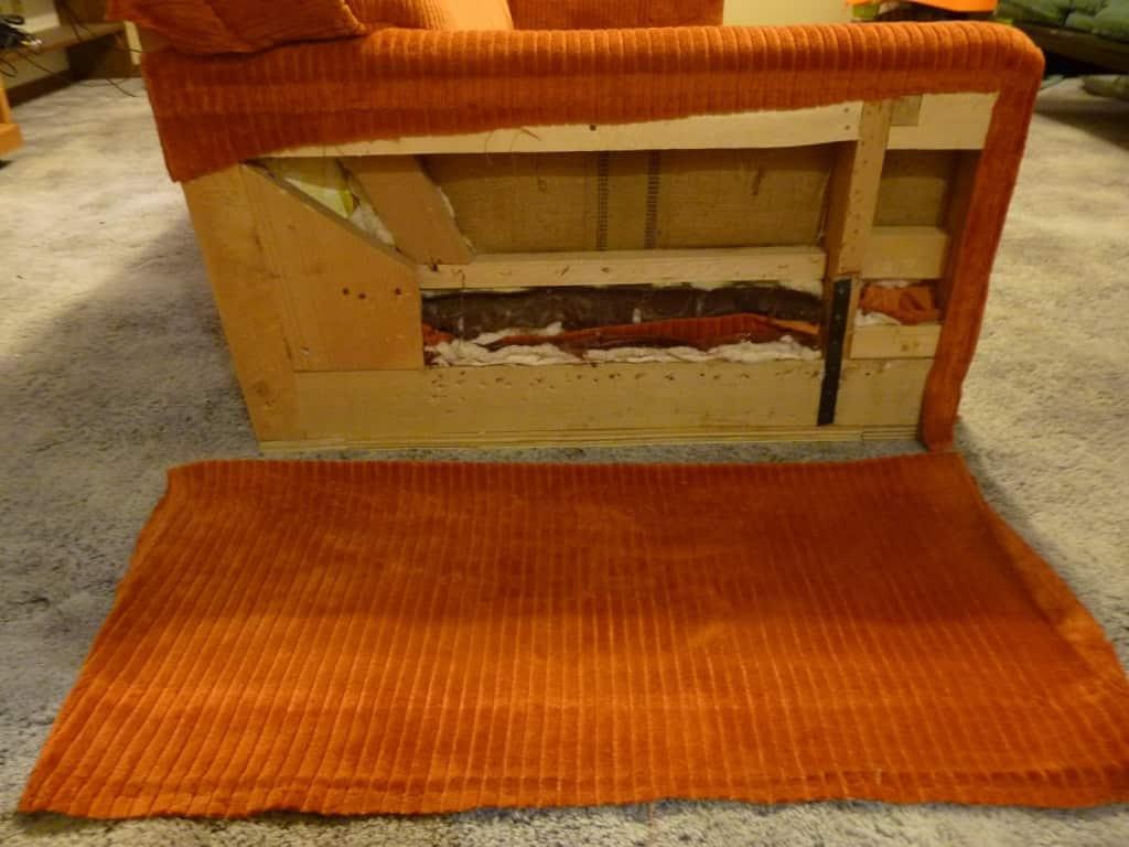 retirado de tela posterior de sillón para tapizar