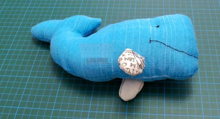 Costura de aletas para almohadón de tela