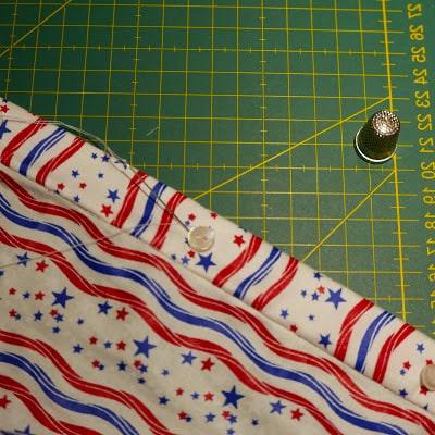 costura de botones a camisa