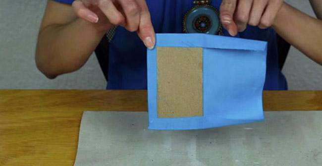 colocación de papel kraft  para funda de celula de tela r