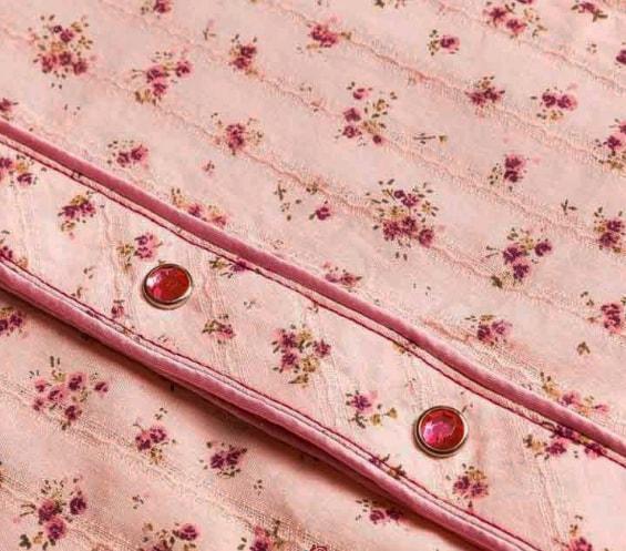 costura de botones para pijama de tela
