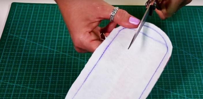 corte en los laterales de telas para funda de cables