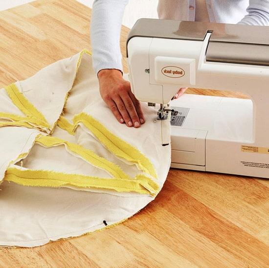 costura de las telas del puff