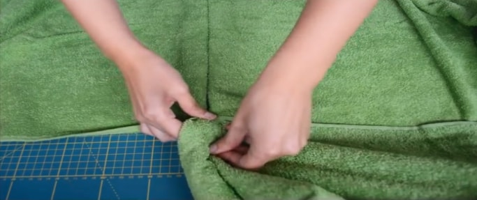 unión de tela de capucha a la toalla