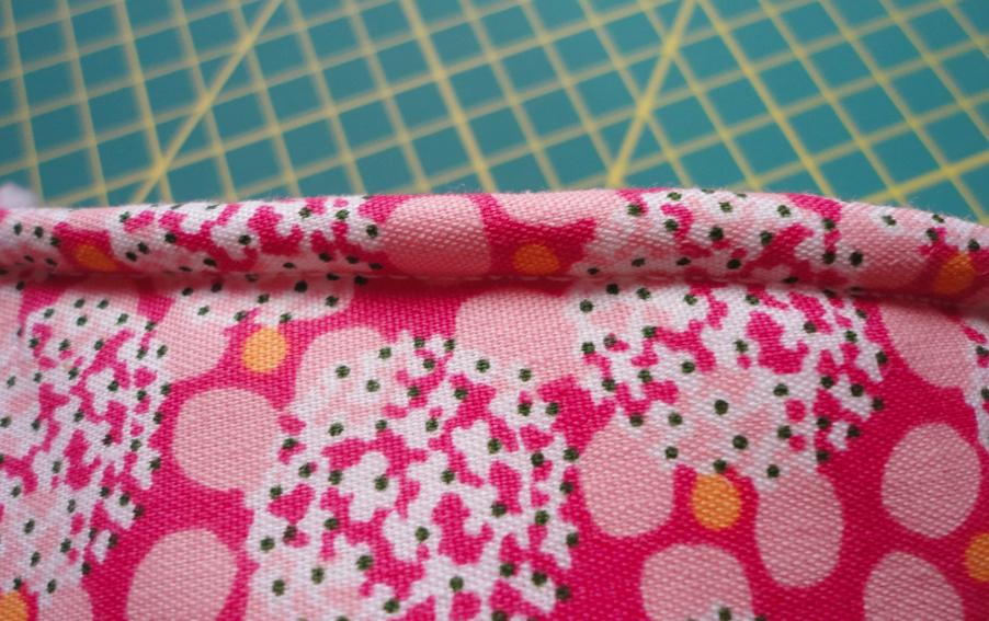 terminación de costura de telas para manopla