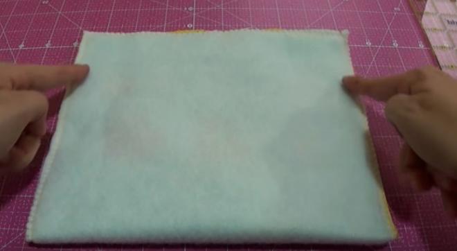 costura de laterales de tela externa para bolsita de cuna