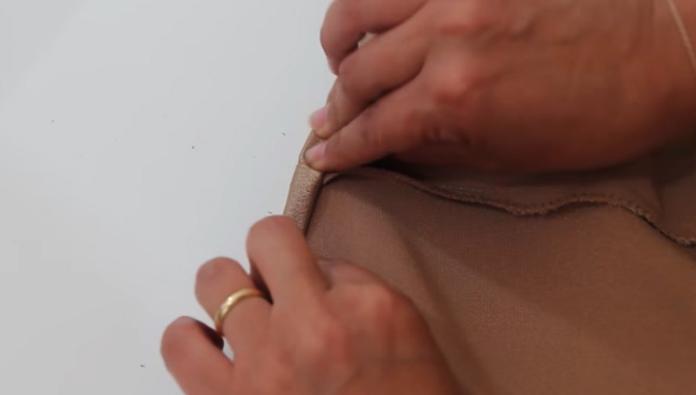 realización de dobladillo para blusa lencera de tela