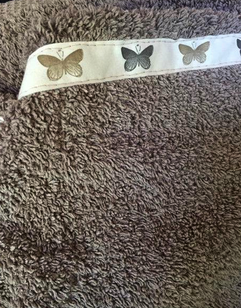 costura de cinta en la tela para repasador decorado