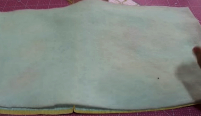 unión de huata a la tela externa para bolsita de cuna