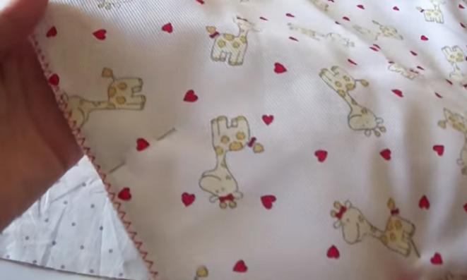 costura de tela exterior y huata para bolsa de bebé