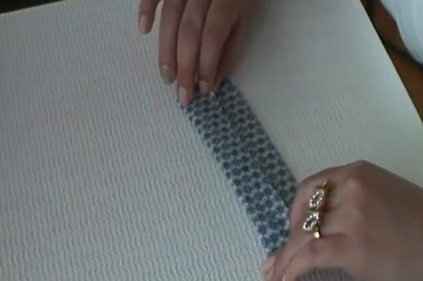 terminación de pegado de tela sobre cartón para separador