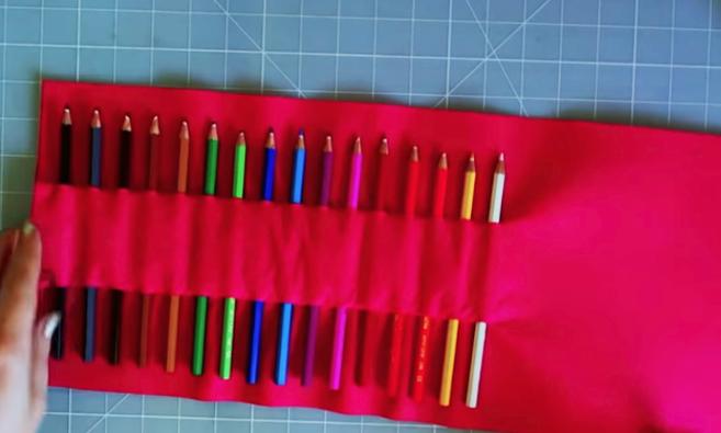 introducción de lápices en la tela