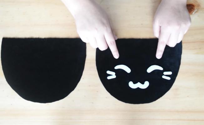 realización de cara de gatito para pantuflas de tela
