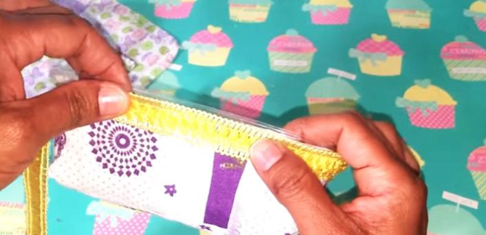 colocación de cinta decorativa para costurero de tela