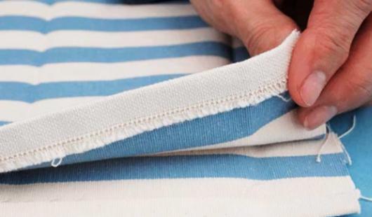 marcado y costura de dobladillo de bolsillo para porta comandos de tela