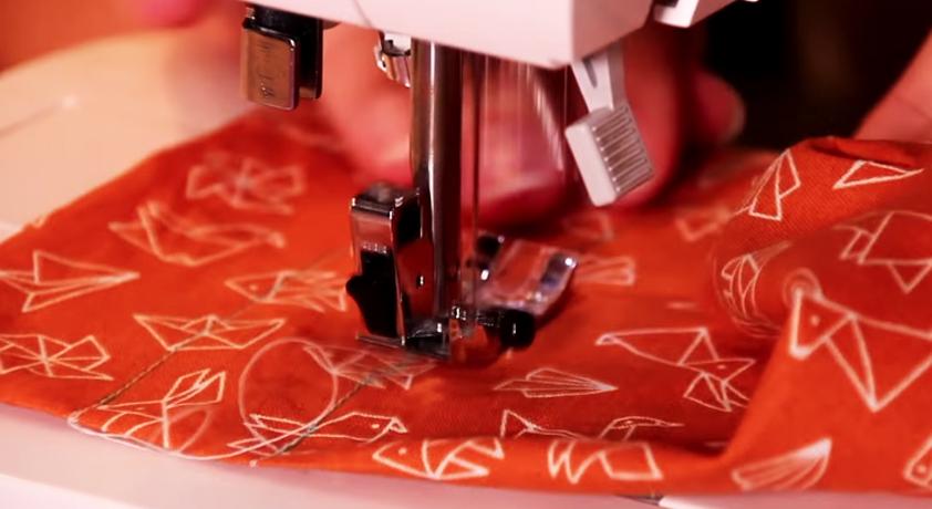 costura de lineas sobre tela para soporte de celular