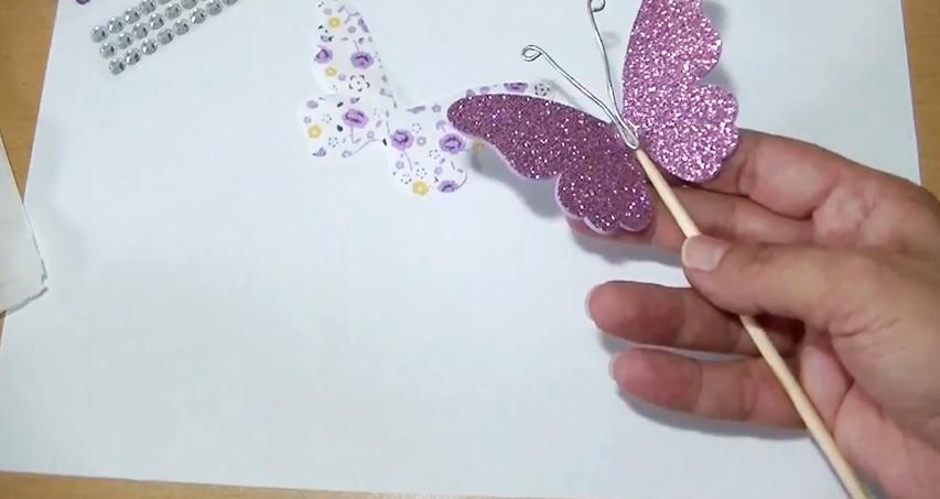 pegado de antenas para móvil de mariposa en tela